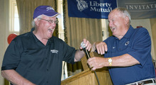 Al Hartmann  |  The Salt Lake Tribune Former Utah football coach and now Weber State University Coach Ron McBride, left, trades barbs with his old friend, former BYU Coach LaVell Edwards at the Liberty Mutual Invitational BYU-Utah golf outing at the Salt Lake Country Club on Monday, June 6.
