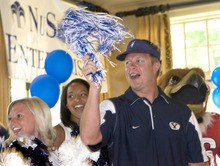 Al Hartmann  |  The Salt Lake Tribune BYU football coach Brono Mendenhall, whose blue team lost at the Liberty Mutual Invitational to the red Ute team, sings the Utah fight song in consolation but still waves a blue and white pompom.  He gets help from the BYU and Utah cheerleaders and team mascots.  The benefit golf tournament was held at the Salt Lake Country Club on Monday, June 6.