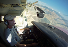 Francisco Kjolseth  |  The Salt Lake Tribune EcoFlight pilot Gary Kraft flew over the Kennecott copper mine on Monday. Alaskans worried about a massive copper mine proposed for their state flew over the Kennecott mine for a look alongside local air quality activists discussing local expansion plans.