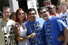 Scott Sommerdorf     The Salt Lake Tribune Pride Parade watchers on 200 South, Sunday, June 5, 2011.