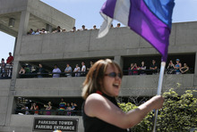 Scott Sommerdorf     The Salt Lake Tribune People watch from the Parkside Tower parking garage as the Utah Pride parade heads down 200 South, Sunday, June 5, 2011.