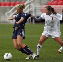 Stephen Holt  |  Special to the Tribune  Park City's Sydney Hieber tries to part Juan Diego's Emily Bruder from the ball during the 3A state champion game in Rio Tinto Stadium.