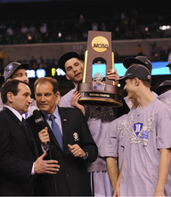 Courtesy Jeffrey R. Staab  |  CBS Duke head coach Mike Krzyzewski, left, talks with CBS lead college basketball play-by-play announcer Jim Nantz following the 2010 NCAA basketball championship game.