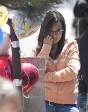 Margaret Distler  |  The Salt Lake Tribune  Erinn Walker reflects on the afternoon of Thursday, June 9, 2011, near the memorial placed at the site where their friend, Shariah Casper, was hit by a train the previous day.