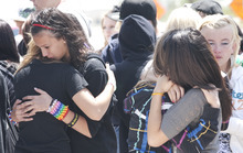 Margaret Distler  |  The Salt Lake Tribune  Allison Delgado (left, facing) grieves with a friend alongside Jessica Huth, Jenny Kandavong and Nicole Anthony on Thursday, June 9, 2011, near the memorial placed at the site where Shariah Casper was hit by a train the previous day.