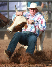Rick Egan l The Salt Lake Tribune  Kolby Hughes, Dixie, rides in the steer wrestling competition at the Utah High School Rodeo Championship round in Heber City, Saturday, June 10, 2011.