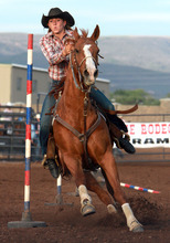 Rick Egan l The Salt Lake Tribune   competes in the pole bending competition at the Utah High School Rodeo Championship round in Heber City, Saturday, June 10, 2011.