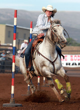 Rick Egan l The Salt Lake Tribune  Sammi Trapp, Lehi, competes in the pole bending competition at the Utah High School Rodeo Championship round in Heber City, Saturday, June 10, 2011.