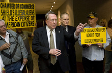 AL HARTMANN  |  The Salt Lake Tribune   Former U.S. Rep. Merrill Cook files a petition at the Salt Lake County Clerk's office on Tuesday to put a measure on the 2012 ballot to penalize companies for hiring undocumented workers and to get rid of HB116.