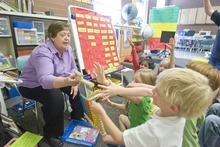 Paul Fraughton     The Salt Lake Tribune  Carolyn Zaugg, a kindergatren teacher at Salt Lake City's Hawthorne Elementary, interacts Tuesday with her last  group of students, as she is retiring after 28 years  of teaching.