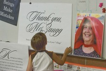 Paul Fraughton     The Salt Lake Tribune   A student looks at a giant thank you note Tuesday written to  kindergarten teacher Caolyn Zaugg at Salt Lake City's Hawthorne Elementary. Zaugg is retiring at the end of the school year  after 28 years  of teaching.