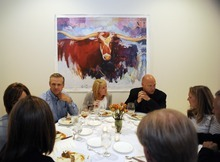 Sarah A. Miller  |  The Salt Lake Tribune Diners enjoy a three-course meal under a painting by Park City artist Josee Nadeau during the By Invitation Only dinner held at the Maple Heights Condominium complex in Salt Lake City on May 28. By Invitation Only is an underground restaurant that takes place once a month in Salt Lake City and Park City. Owner Justin Kinnaird sets up a dinner at a different