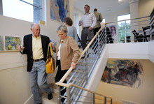 Sarah A. Miller  |  The Salt Lake Tribune Tim and Mary Miller of Sandy walk downstairs to look at the artwork by Park City artist Josee Nadeau during the By Invitation Only dinner held at the Maple Heights Condominium complex in Salt Lake City on May 28, 2011. By Invitation Only is an underground restaurant that takes place once a month in Salt Lake City and Park City. Kinnaird sets up a dinner at a different