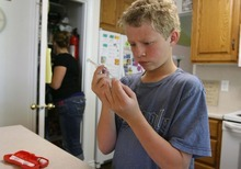 Leah Hogsten  |  The Salt Lake Tribune Ethan Erickson, 11, inspects one of his insulin shots Friday in Taylorsville. Ethan will address Congress next week on behalf of the Juvenile Diabetes Research Foundation about efforts to increase funding for research into Type 1 diabetes.