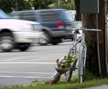 Margaret Distler  |  The Salt Lake Tribune  A ghost bike memorial for Brynn Barton was placed on the corner of 700 East and 800 South on Wednesday, June 8, 2011.