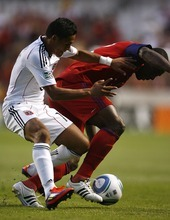 Djamila Grossman     The Salt Lake Tribune  Real Salt Lake plays D.C. United at Rio Tinto Stadium in Sandy, Utah, on Saturday, June 18, 2011.  RSL's Jean Alexandre (12) defends the ball against D.C.'s Andy Najar (14), in the second half of the game.