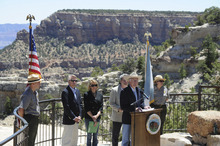 In this photo provided by the U.S. Department of the Interior, Interior Secretary Ken Salazar speaks at a news conference on the at Mather Point at the rim of the Grand Canyon in Arizona Monday, June 20, 2011. The Interior Department has extended a temporary ban on the filing of new mining claims near the Grand Canyon with an eye toward protecting 1 million acres (400,000 hectares) and giving the federal government more time to study the economic and environmental effects of mining. (AP Photo/U.S. Department of the Interior)