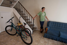 In this Wednesday, Sept, 1, 2010 file picture, Ievgen Kondzateko, an 18-year-old student from the Ukraine stands by his only form or transportration, bicycles he found in the garbage as he talks about how he ended up in Destin, FL on his J-1 visa. Kondzateko was promised a job as a lifeguard with a certain amount of hours per week by the company charging foreign students to come to the United States for summer work. Instead, the lifeguard job was not available and he was hardly able to make ends meet and lived in pauper conditions. The State Department is acknowledging that one of its most popular exchange programs leaves foreign college students vulnerable to exploitation. It's unclear if new regulations the agency is pushing will stop the abuses. The revised rules which take effect July 15, 2011 will shift more responsibility onto companies designated sponsors in the J-1 Summer Work Travel Program. (AP Photo/Mari Darr-Welch)