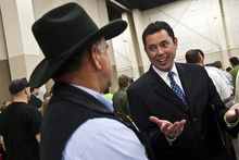 Chris Detrick  |  The Salt Lake Tribune  Rep. Jason Chaffetz talks to supporter John Long, of American Fork, during the Utah State Republican Party Convention at the South Towne Expo Center on Saturday.