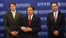 Steve Griffin     The Salt Lake Tribune  Utah Governor Gary Herbert, center, stands with Vance Checketts, of EMC, left, and Keyvan Esfarjani, co-executive officer of IM Flash, during an announcement Monday of significant job increases by the two Utah companies.