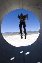 Al Hartmann  |  The Salt Lake Tribune Mathu Gaia  explores the Sun Tunnels on summer solstice on Tuesday near Lucin.
