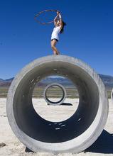 Al Hartmann  |  The Salt Lake Tribune Tara Thornley, does some free form hula hoop atop the Sun Tunnels, celebrating Summer Solstice on Tuesday, June 21 near Lucin.