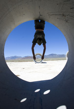 Al Hartmann  |  The Salt Lake Tribune Mathu Gaia hangs from the edge of one of the Sun Tunnels to get a different perspective Tuesday near Lucin. Artist Nancy Holt created the Sun Tunnels, four concrete culverts arranged to align with the sun on summer solstice.
