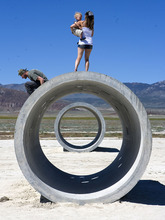 Al Hartmann  |  The Salt Lake Tribune  Tara Thornely holds her son Tama Gaia, 3, and takes in the view of the desert as her husband, Mathu Gaia, hops down from the Sun Tunnels on Tuesday near Lucin.