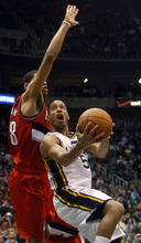 Chris Detrick | The Salt Lake Tribune  Utah Jazz point guard Devin Harris (5) shoots around Portland Trail Blazers small forward Nicolas Batum (88) during the first half of the game at EnergySolutions Arena Thursday April 7, 2011.