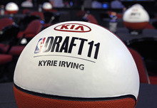 Basketballs sit on tables for the famlies of draftees, including Kyrie Irving, of Duke, before the NBA basketball draft in Newark, N.J., Thursday, June, 23, 2011. (AP Photo/Mel Evans)