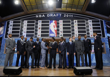 NBA draft prospects Kemba Walker, of Connecticut, center left, and Kyrie Irving, of Duke, shake hands as they stand on a stage with other prospects before the NBA basketball draft Thursday, June, 23, 2011, in Newark, N.J. (AP Photo/Bill Kostroun)