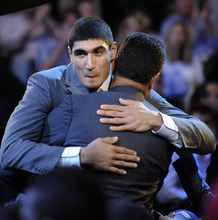 Kentucky's Enes Kanter, from Turkey, who was selected with the No. 3 pick by the Utah Jazz, gets a hug at the NBA basketball draft Thursday, June, 23, 2011, in Newark, N.J. (AP Photo/Bill Kostroun)