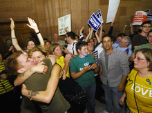 Supporters of same sex marriage celebrate after Senate members voted and approved same-sex marriage at the Capitol in Albany, N.Y., Friday, June 24, 2011. Gov. Andrew Cuomo later signed the bill into law. (AP Photo/Hans Pennink)