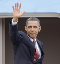 President Barack Obama waves prior to boarding Air Force One at Andrews Air Force Base, Md., Thursday,  June 23, 2011.  (AP Photo/Luis M. Alvarez)