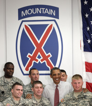 President Barack Obama is photographed with soldiers from the 10th Mountain Division, many of whom have just returned from Afghanistan, Thursday, June 23, 2011, in Fort Drum, N.Y.  (AP Photo/Carolyn Kaster)