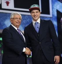 NBA Commissioner David Stern, left, poses with BYU's Jimmer Fredette, who was selected by the Milwaukee Bucks with the No. 10 pick in the NBA basketball draft Thursday, June, 23, 2011, in Newark, N.J. (AP Photo/Bill Kostroun)