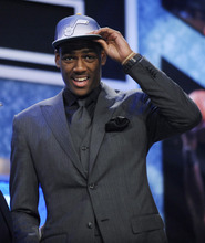 Colorado's Alec Burks, who was selected by the Utah Jazz with the 12th pick during the NBA basketball draft, touches his Jazz cap on Thursday, June 23, 2011, in Newark, N.J. (AP Photo/Bill Kostroun)