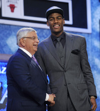 NBA Commissioner David Stern, left, poses Colorado's Alec Burks, who was selected with the 12th pick by the Utah Jazz in the NBA basketball draft Thursday, June 23, 2011, in Newark, N.J. (AP Photo/Mel Evans)