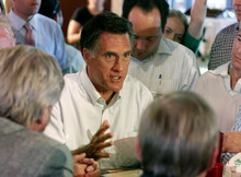 Republican presidential candidate Mitt Romney, center, speaks as he met with small business owners during a campaign stop in Aurora, Colo., Monday, June 20, 2011. The former Massachusetts governor returned to Colorado for the first time as a presidential candidate Monday, more than three years since he easily won the state's presidential caucuses over the eventual Republican nominee, Sen. John McCain. (AP Photo/Ed Andrieski)