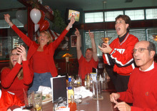 Ute fans watch a football game at Iggy's sports bar in this 2003 Tribune file photo.
