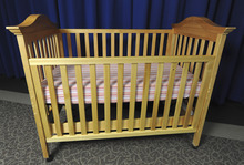 This undated image provided by the Consumer Product Safety Commission (CPSC) shows a drop-side crib. It's one of the biggest purchase for soon-to-be parents: a crib for baby. Beginning Tuesday, a new generation of cribs, ones that are supposed to be safer, will be the only ones allowed to be sold across the country - in stores, online and even in neighborhood yard sales.   (AP Photo/Consumer Product Safety Commission ) NO SALES