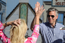 Former Utah Gov. Jon Huntsman, and his wife, Mary Kaye, celebrate after competing in a Fast Draw competition during a campaign stop at the Reno Rodeo in Reno, Nev., Friday, June 24, 2011. (AP Photo/Kevin Clifford).
