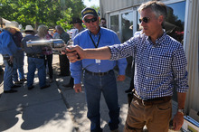 Former Utah Gov. Jon Huntsman practices his fast draw with a Colt .45 during a campaign stop at the Reno Rodeo in Reno, Nev., Friday, June 24, 2011. ( AP Photo/Kevin Clifford).
