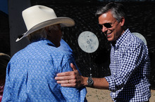 Former Utah Gov. Jon Huntsman, talks to Paul Yeager of Reno, Nev., after competing in a Fast Draw competition during a campaign stop at the Reno Rodeo in Reno, Nev., Friday, June 24, 2011. (AP Photo/Kevin Clifford).