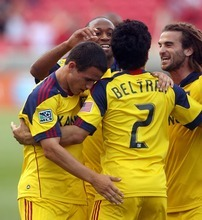 Steve Griffin  |  The Salt Lake Tribune  Real Salt Lake's Tony Beltran, center, is congratulated by his teammates after scoring the first goal of the game during first half action in the Real Salt Lake versus Wilmington soccer match at Rio Tinto Stadium in Sandy, Utah Tuesday, June 28, 2011.