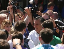 LEAH HOGSTEN     The Salt Lake Tribune Mitt Romney is surrounded by supporters on Friday during his one public appearance of the trip -- at the Hires Big H Drive-in in Salt Lake City. Advisers to the former Olympics chief are pushing to move up Utah's primary on 2012 calendar.