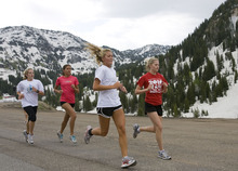 Al Hartmann  |  The Salt Lake Tribune Members of the Alta High School cross country team take a high-altitude training run near Alta at the top of Little Cottonwood Canyon on Wednesday. The high country snowpack has lasted farther into the summer than usual.