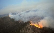 Eddie Moore, Albuquerque Journal  |  The Associated Press  Flames from the Las Conchas Fire move toward Los Alamos, N.M,. in the Jemez Mountains, on Tuesday. Wildfires in Arizona and New Mexico have led to Western governors' concerns that nearby states face the same fate.