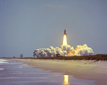 The first flight of Challenger on mission STS-6 on April 4, 1983. The primary payload is the first Tracking and Data Relay Satellite-1. The mission also is using the first lightweight external tank and lightweight solid rocket booster casings. The crew comprises Commander Paul J. Weitz, Pilot Karol J. Bobko, and Mission Specialists Donald H. Peterson and F. Story Musgrave. (NASA)