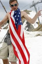 Rick Egan   |  The Salt Lake Tribune  Joe Wall, Salt Lake City wears the flag around his neck as he snowboards, at Snowbird, Monday, July, 4, 2011